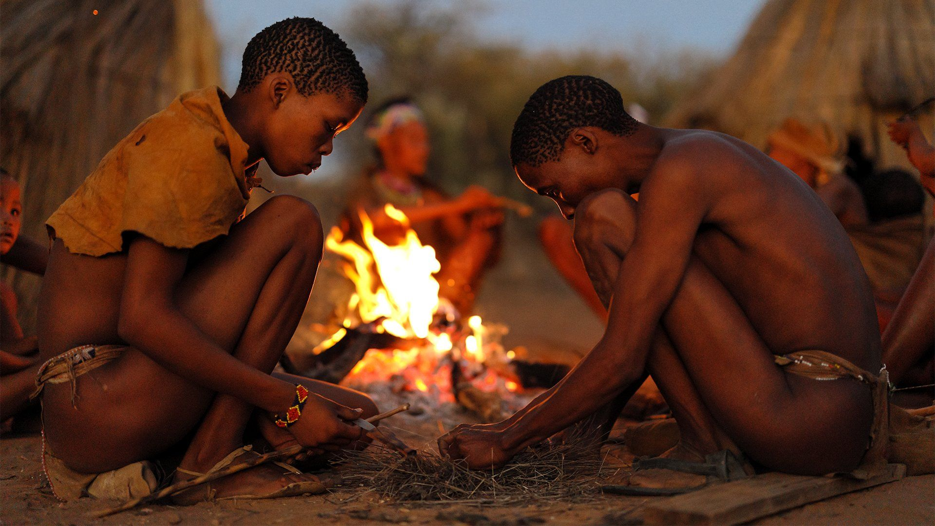 Brent Stirton two males starting a fire sample